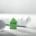 Beitragsbild für Blogbeitrag Green Engineering Energiewende: Rollen mit Engineering Plänen und kleines grünes Haus aus Bauklötzen